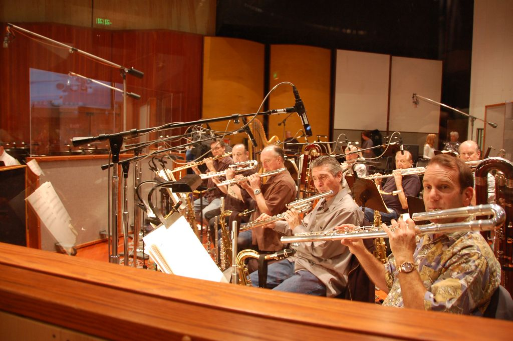photo of eight bass flute players